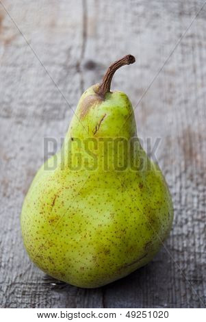 Green Duchesse Pear On Wood