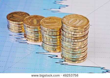 Uptrend Stacks Coins,on The Financial Stock Charts As Background. Selective Focus
