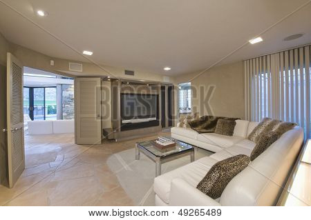View of a modern and spacious television area at home