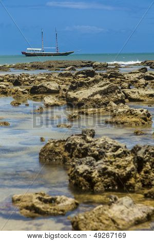Boat Behind A Reef