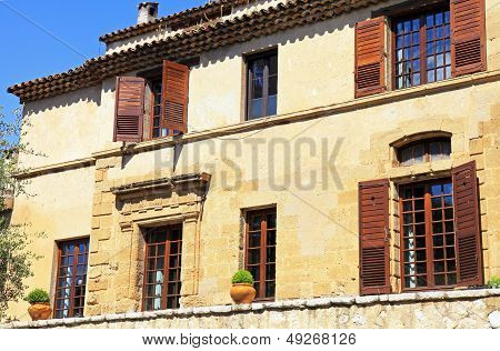 Rural Sandstone House With Shutter Windows In Saint-paul De Ven