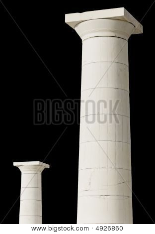 Pair of Greek doric pillars isolated and ready cropped on black background