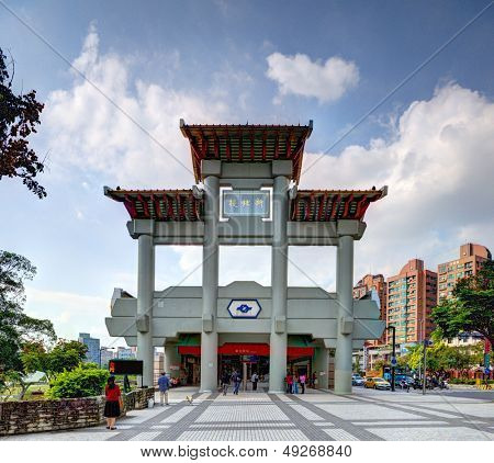 TAIPEI, TAIWAN - JANUARY 16: People walk in front of Xinbeitou Station January 16, 2013 in Taipei, TW. The station is closest to the famed hot springs of Beitou.