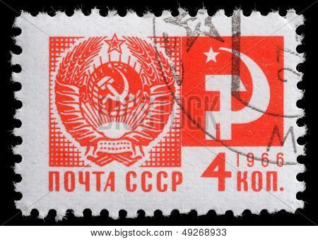"USSR - CIRCA 1966: A stamp printed in USSR from the ""Society and Technology"" issue shows the Coat of Arms and communism emblem, circa 1966."
