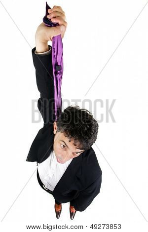 Humorous high angle portrait of a businessman committing suicide holding up his tie as though it were a hangman rope and dangling his head, isolated on white