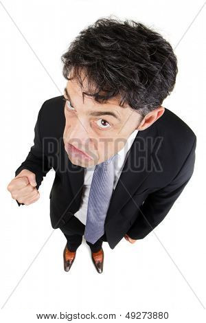 Humorous high angle full length portrait of an angry businessman and making a fist, isolated on white