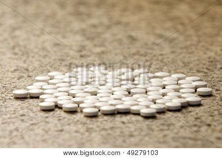 Flat Group Of Generic White Pills On Hard Surface
