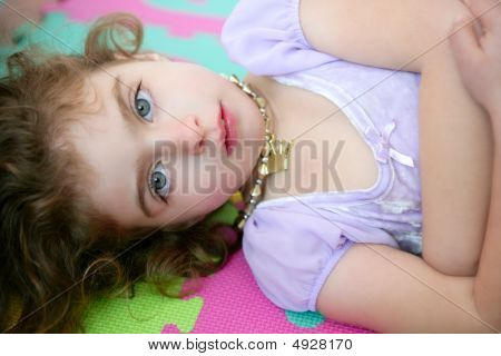 Beautiful Blue Eyes Little Girl Lying On Floor