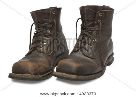 Two Old Brown Boots Isolated On White