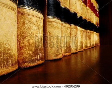 Row of old leather books on a shelf