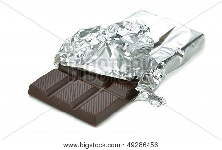 A bar of chocolate in tin foil wrapper