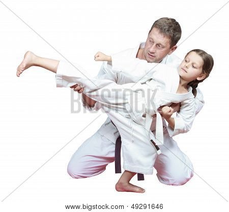 Sports family dad teaches daughter to beat kick leg
