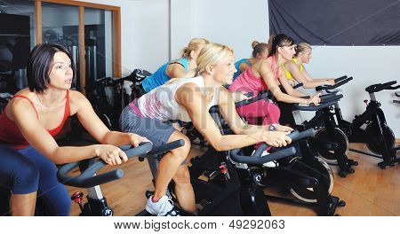 Beautiful Women Doing Exercise In A Class At Gym