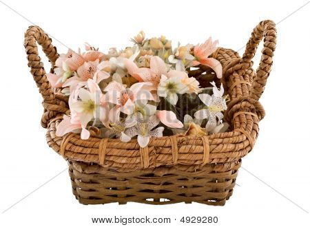 Decorative traditional wick basket with fake flowers in it