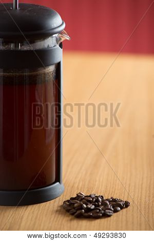 Closeup Of Cafetiere With Coffee Beans In Front