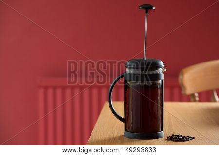 Freshly Brewed Coffee On Table In Red Room In A Cafetiere