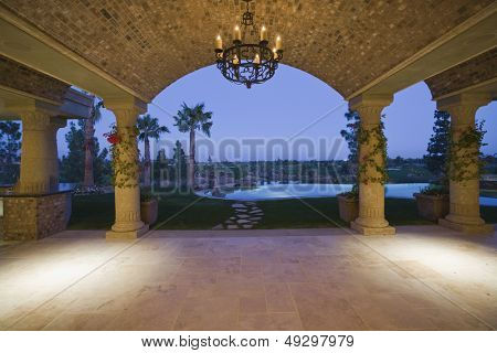 Scenic view of landscape and pool through arched structure