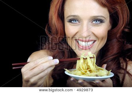 Woman With Plate Of Pasta