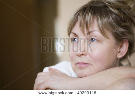 Closeup of a pensive middle aged woman