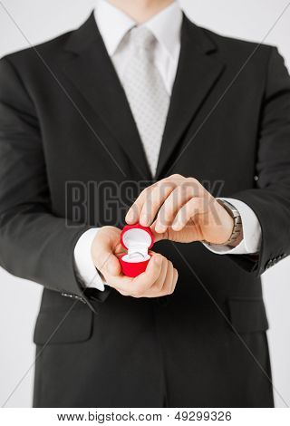 picture of man with gift box and wedding ring