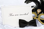 stock photo of black tie  - Invitation to mask party place on white satin - JPG