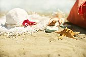 stock photo of echinoderms  - Collection of beach items - seastar, flip-flops, sunglasses and hat