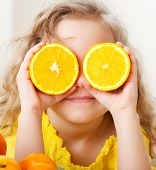 stock photo of mandarin orange  - Child with oranges - JPG