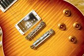 stock photo of clos  - Close up of a Lacquer electric guitar on wooden surface - JPG
