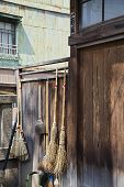 stock photo of kanto  - Straw Brooms on Fence at Shitaya Jinja Shinto Shrine - JPG