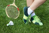 picture of leggy  - foot of woman who plays badminton on grass - JPG
