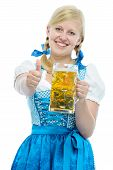foto of stein  - Bavarian girl in Oktoberfest dirndl holds Oktoberfest beer stein and shows thumb up - JPG