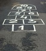 stock photo of hopscotch  - The game hopscotch for children in yard on asphalt - JPG