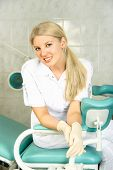 picture of gynecological exam  - beautiful young doctor sitting on the gynecological chair in her office - JPG