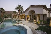 pic of hacienda  - Luxury swimming pool and house exterior at dusk - JPG