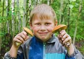 picture of face-fungus  - The joyful child who has found two aspen mushrooms against wood - JPG