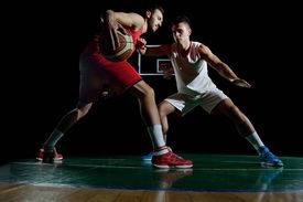 foto of slam  - basketball game sport player in action isolated on black background - JPG