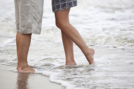 foto of wet pants  - couple kissing on the beach - JPG
