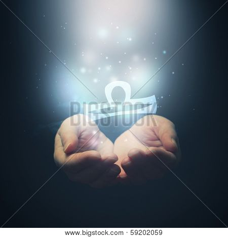 Female Hands Opening To Light And Holding Zodiac Sign For Libra
