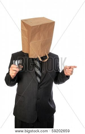 A unidentifiable business man in a grey pin stripe suit wears a paper grocery bag over his head. Isolated on white with room for your text. images are easily cropped out for use anywhere.
