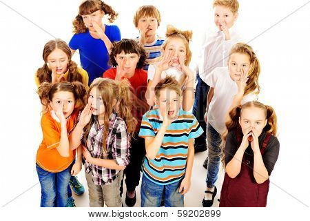 Group of happy children standing together and talking. Isolated over white.