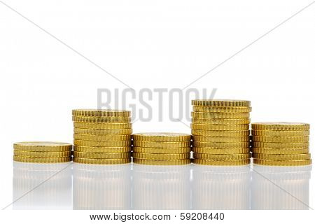 stacked coins, high and low alternating stack, symbol photo for financial planning and fluctuating return