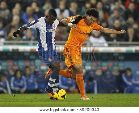 BARCELONA - JAN, 12: Pepe Lima of Real Madrid vies with Jhon Cordoba of RCD Espanyol during the Spanish League match at the  Estadi Cornella on January 12, 2014 in Barcelona, Spain