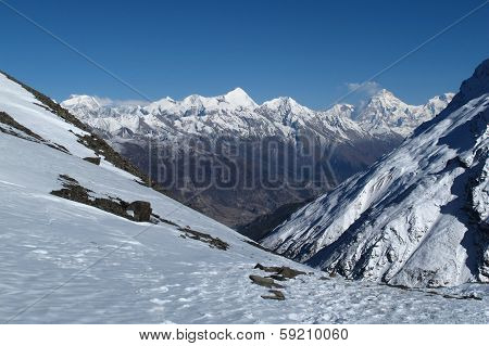 View of Pisang Peak and other snow capped mountains near Manang