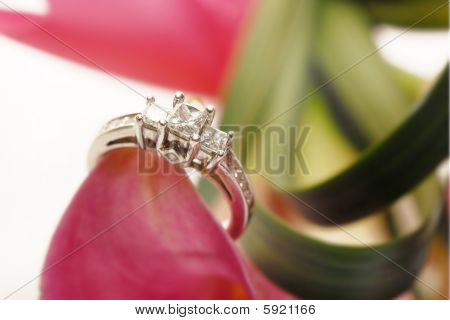 diamond engagement ring on top of flowers