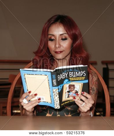 HUNTINGTON, NY-JAN 15: Reality star Nicole 'Snooki' Polizzi signs 'Baby Bumps:From Party Girl to Proud Mama and all the Messy Milestones Along the Way' at Book Revue on January 15, 2014 in Huntington.