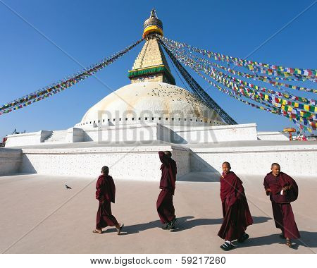 Nepal, Kathmandu -17Th Of December 2013: Tibetan Buddhist Monks Walking Around Boudhanath Stupa Duri