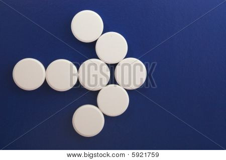 Arrow Of White Tablets