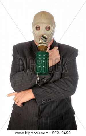 A professional Business Man in a Grey Pin Stripe Suit, wears a green Gas Mask representing, Global Warming, Corporate Greed, Pollution, Big Business, Industrial Waste, Toxic Waste and other concepts.