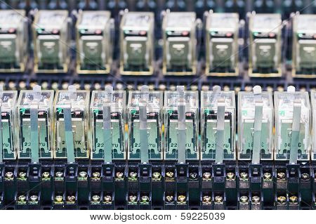 Close Up Row Of Relay Actuators