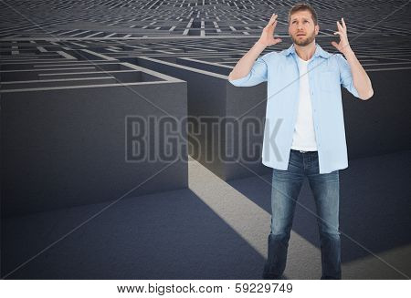 Reproachful man looking up against entrance to difficult maze puzzle